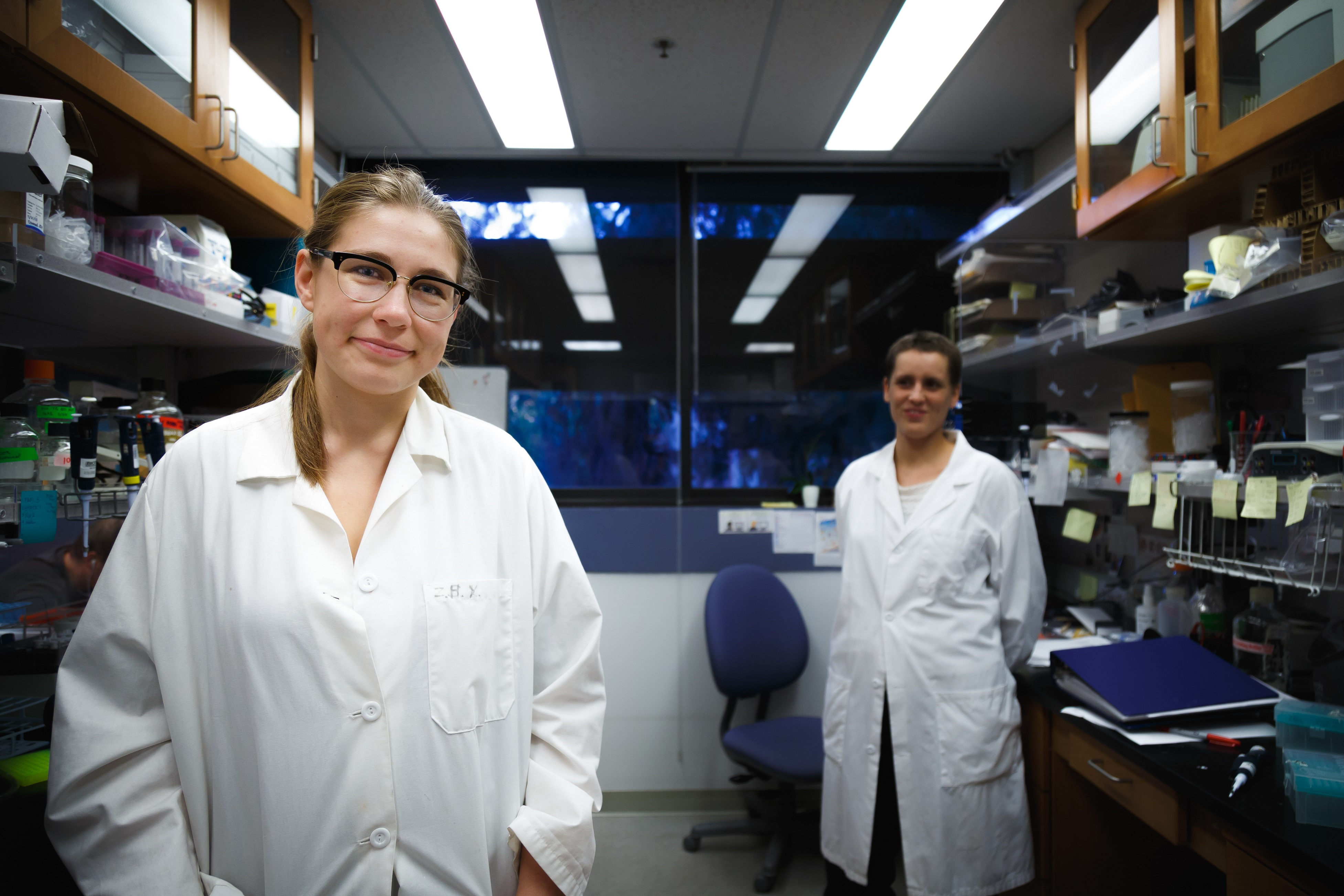 Ariana Nagainis in a white coat in the research lab.