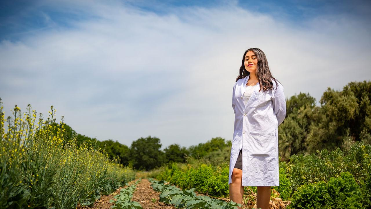 First Generation College Student Yilda Korpela wearing a labcoat