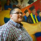 Elizabeth Nunez, First Generation college grad, at the Student Community Center mural.