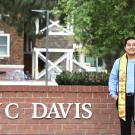 Irving Huerta '20 in front of the UC Davis sign