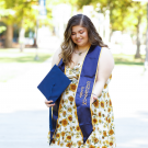 First-generation student, Roseanne Gorelik, standing proudly with her first-gen stole.