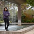 First-generation college student, Joyce Zamorano standing in front of the UC Davis Welcome Center fountain.