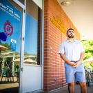 First Generation College Transfer Student, Jose Macias, stands in front of the Center for Chicanx and Latinx Academic Student Success.