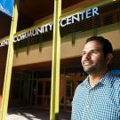 Jose Ballesteros in front of the Student Community Center building.